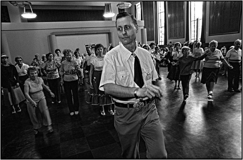 Russell Ericson, a Department of Parks and Recreation  Assistant Recreation Supervisor,   leads seniors in dance at the War Memorial Recreation Center in Brooklyn. 1985.