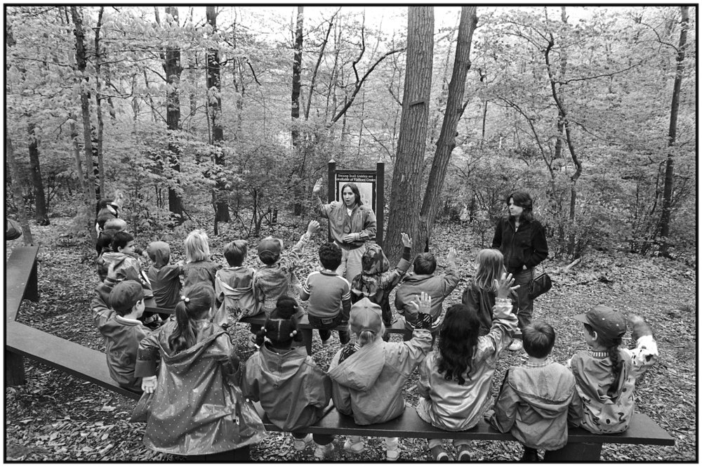 Karen Golop dicusses nature walk with students in Staten Island's High Rock Park. 1988.
