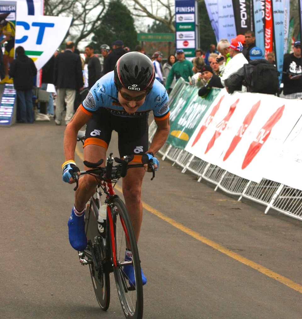 Coach Miller closing in on the finish of the 2012 UCI World Masters' Championship TT.