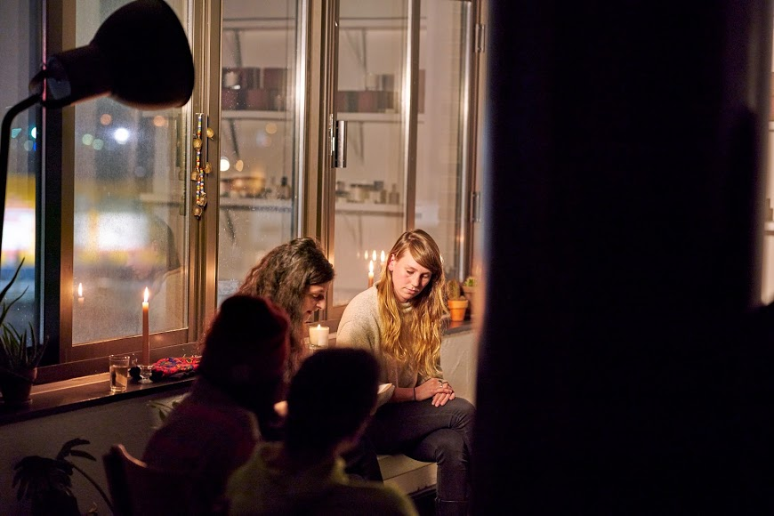 Poets Maia Asshaq and Megan Stockton read original works by candlelight at Souq Studio.