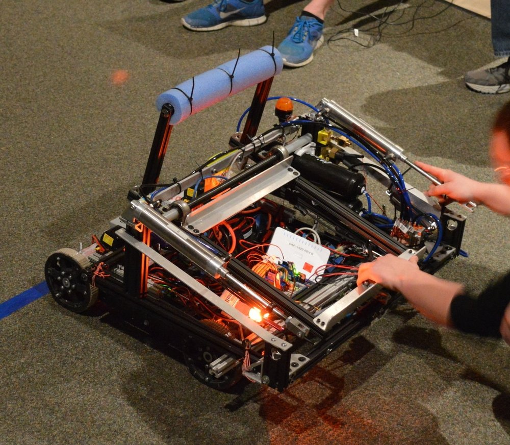 Merlin was created for the Aerial AssistSM challenge in 2014. His main objective was to launch yoga balls over a truss with a built-in catapult while also having the capability to catch launched balls. Merlin's speed and maneuverability are what allowed him to be a very effective team player and rise above other robots in the 2014 competition. Merlin won 12 straight games at our first regional.