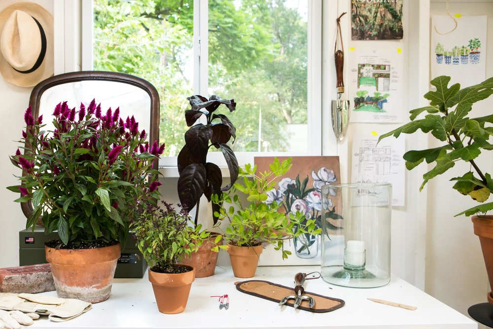 Inspired by landscape designer  Miranda Brooks , Michelle added art, decor, and garden plans to cozy up her potting shed.