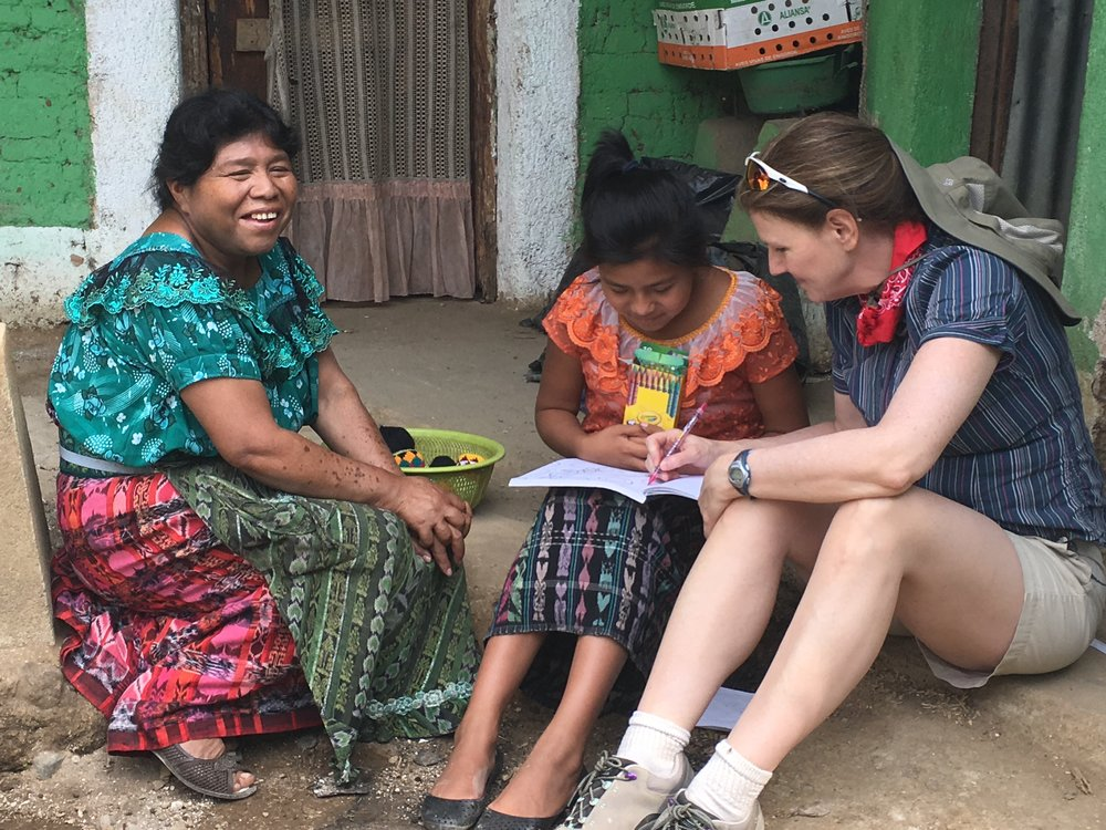 Regan, in San Pablo, Guatemala, sharing her passion for learning with the family who would live in the house she and her Yoga Sanctuary teammates built with the guidance of local masons.