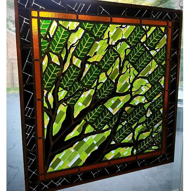 Fused and leaded glass panel of a whole lot of leafy rectangles.  #gordonglass