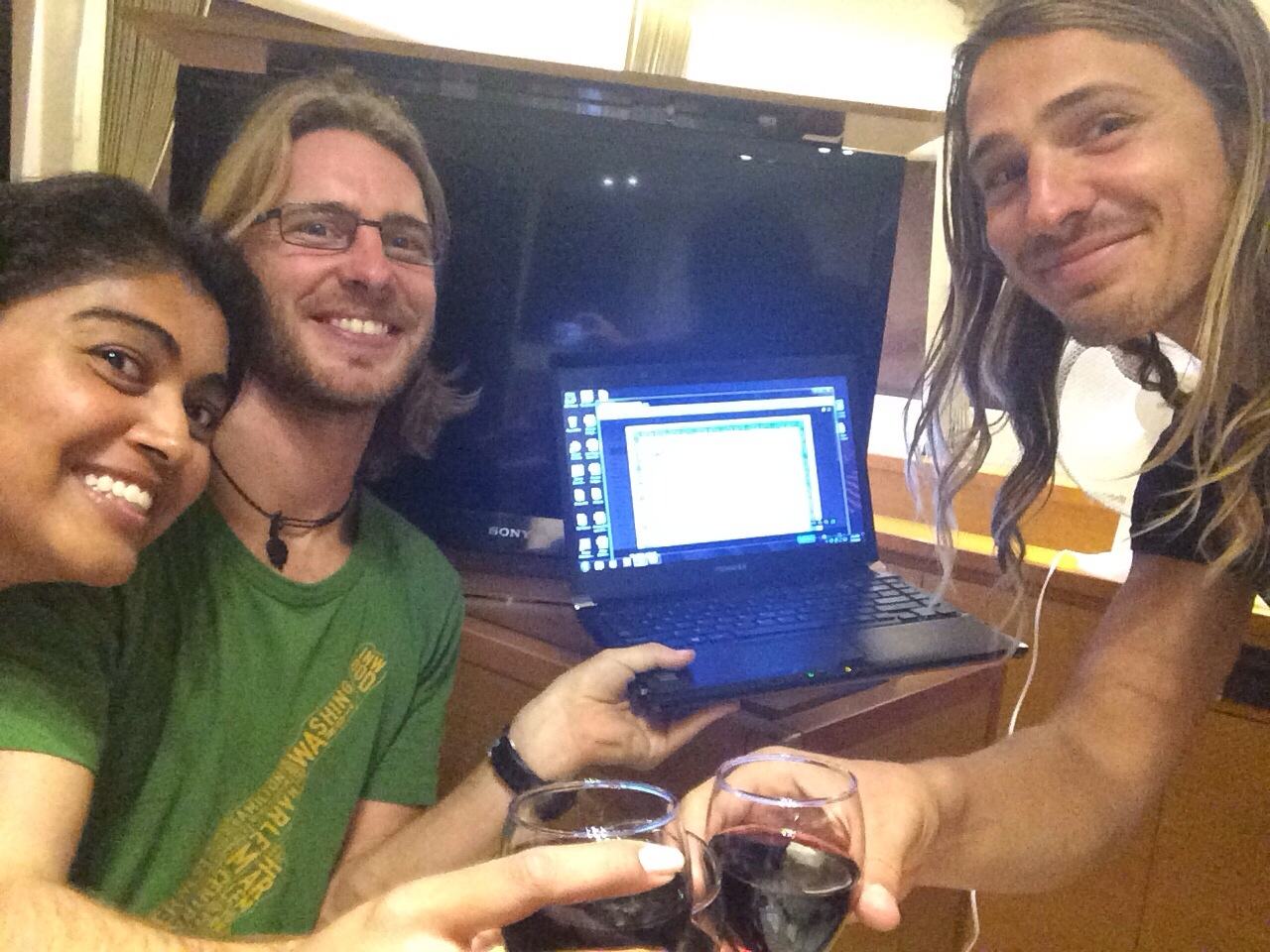 Me, My Captain, the soft copy of our paperwork, and the First Mate, celebrating with some Malbec, brie and hummus!