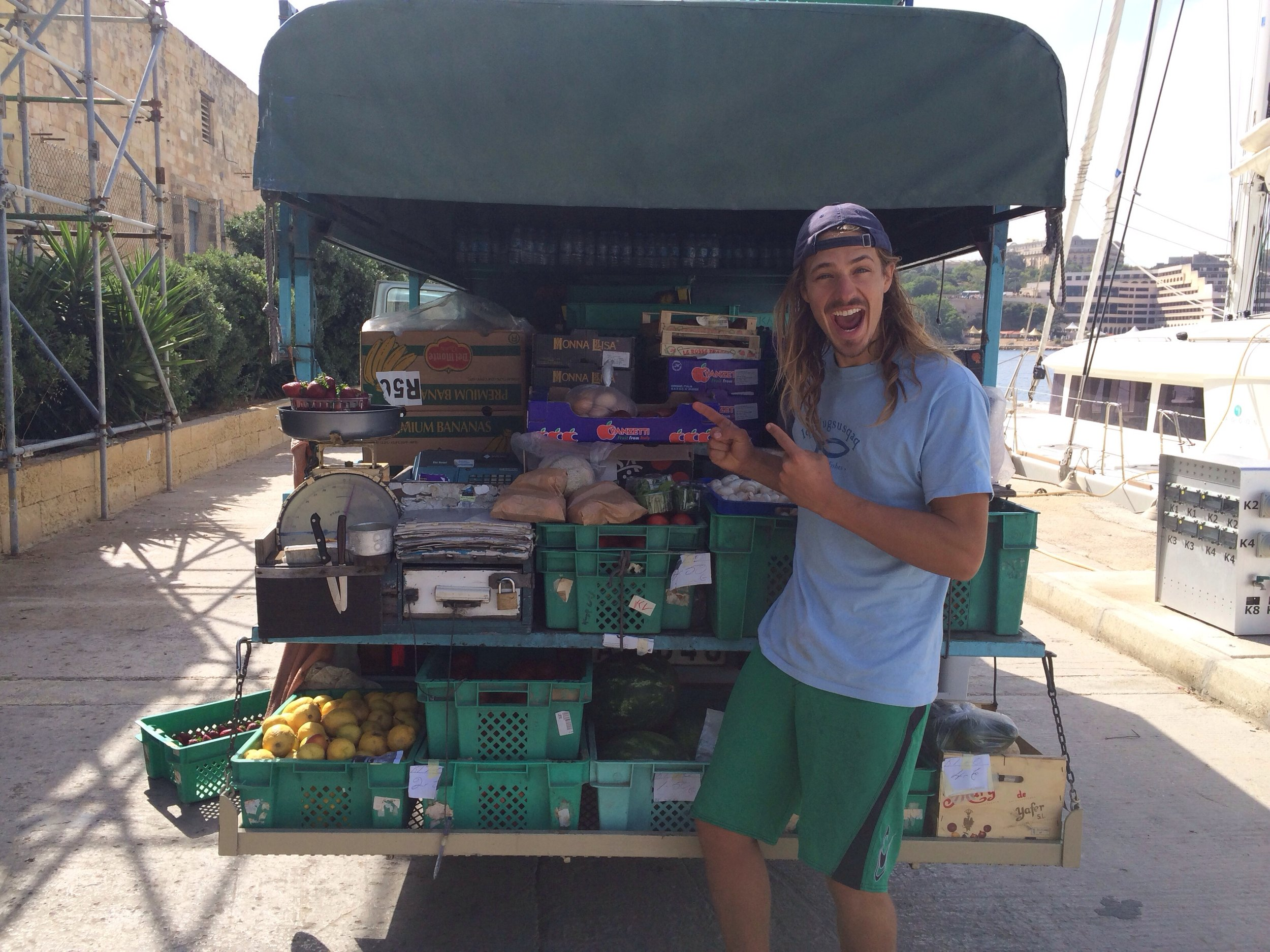 Tyler provisioning for the sail to Gibraltar. Pablo drove up to the boat with his truck full of fresh produce from his farm.