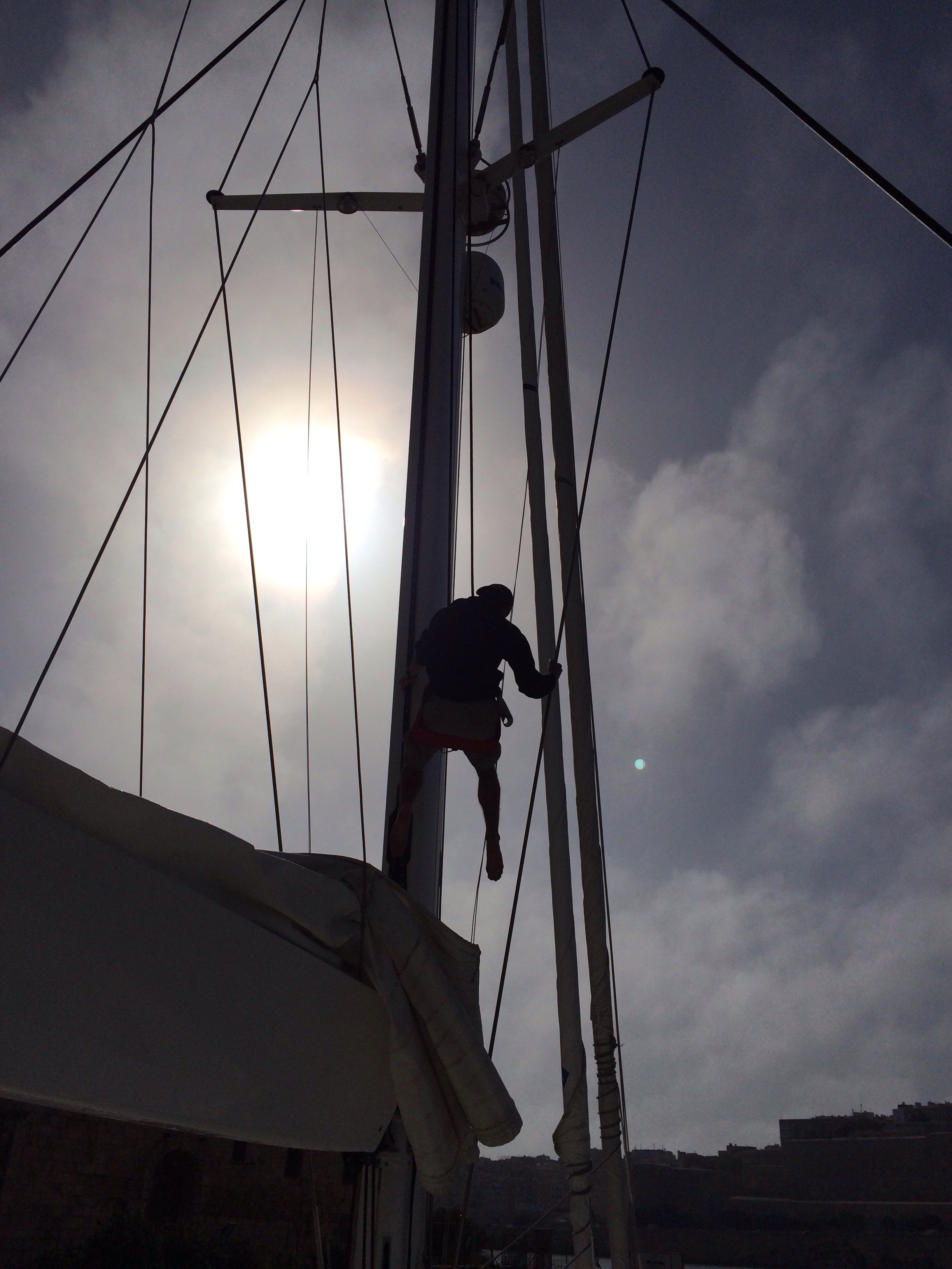 Our new captain, Jorge, climbing the mast.