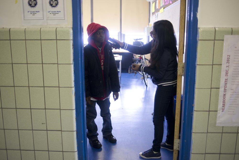 Ms. Bujan jokes with Rasaiah Williams, a ninth grader, after class.