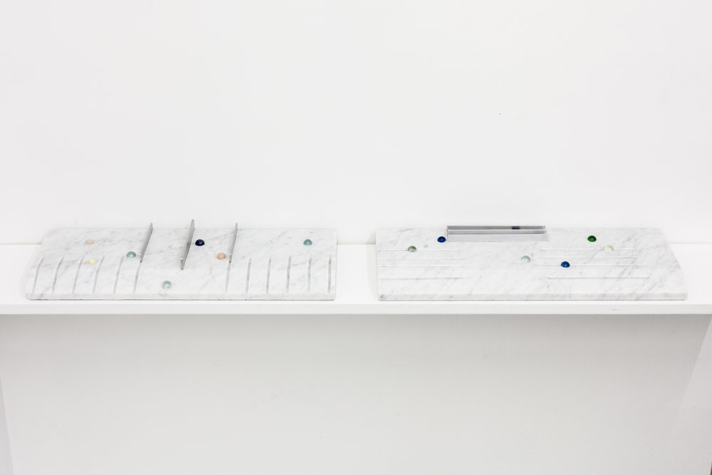 """Short Cut Keys Tablet"" (1, 2)  18"" x 7"" x 2"" Carrara marble slab, glass marbles, aluminum 2018"