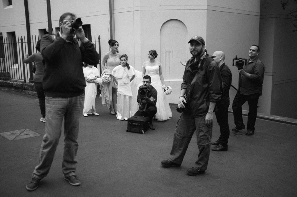 This wedding photographer was looking pretty pissed off that a photo walk had crashed his shoot.