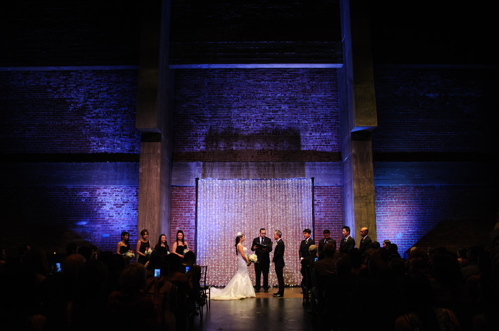 Beautiful uplighting during wedding ceremony at Memorial Auditorium in Sacramento California.