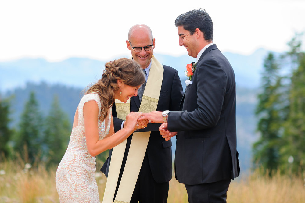 Ring exchange during ceremony at Zephyr Lodge at Northstar California Resort in Truckee California.