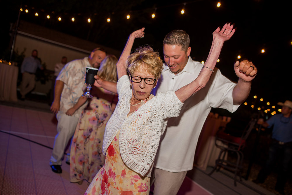 Reception dancing during backyard wedding in Elk Grove California.