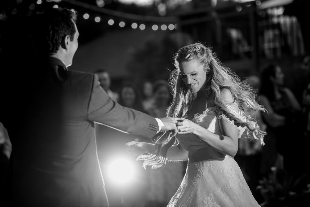 Bride and grooms first dance during backyard wedding reception in Sonoma California.