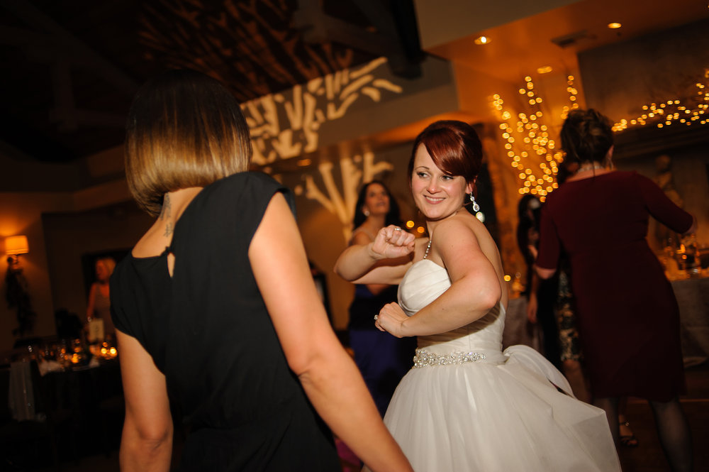 Bride dancing during wedding reception at Wine and Roses in Lodi California.