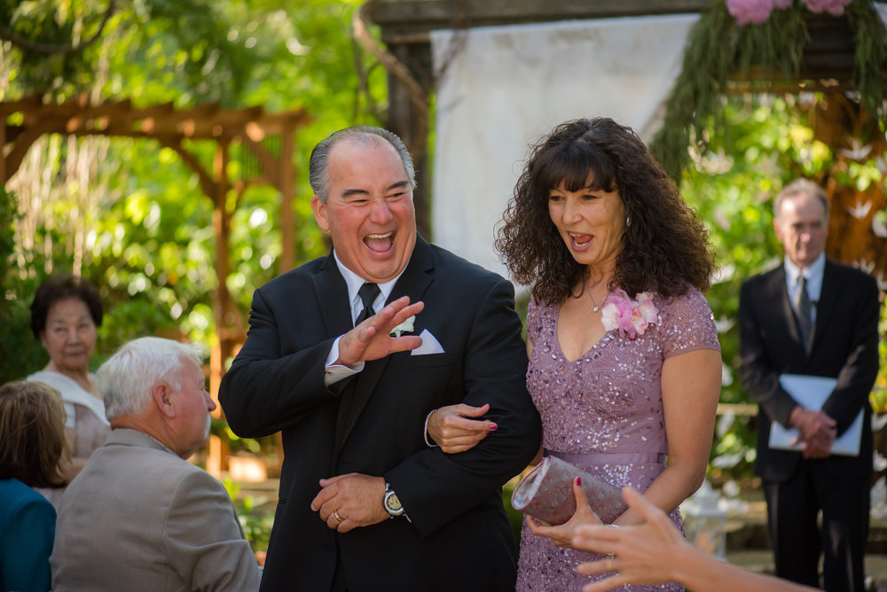 Proud parents after wedding ceremony at the Monte Verde Inn in Foresthill California.