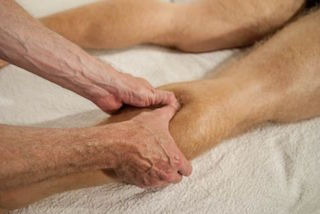 Rehabilitative sports massage for the gastrocnemius muscle.