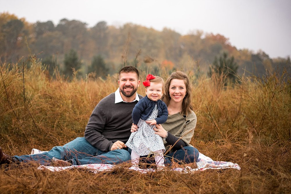 family of 3 in tallk grass at Garrard Landing Park, Roswell, GA