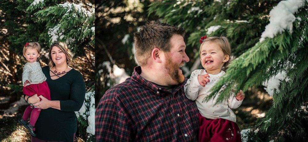 mom, dad, daughter in snow Woodstock, GA