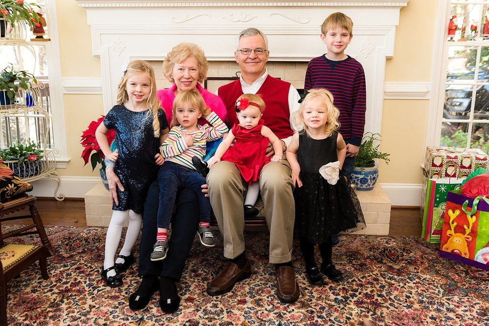 grandparents sitting with 5 grandkids