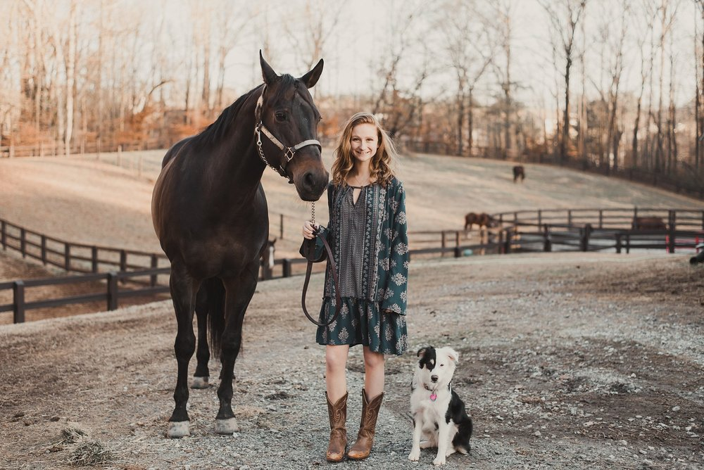 senior girl with her horse and puppy