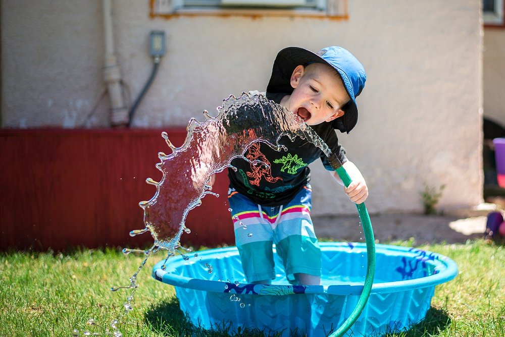 toddler playing in backyard plastic pool | Summer Bucket List | adriennelouisephotography.com
