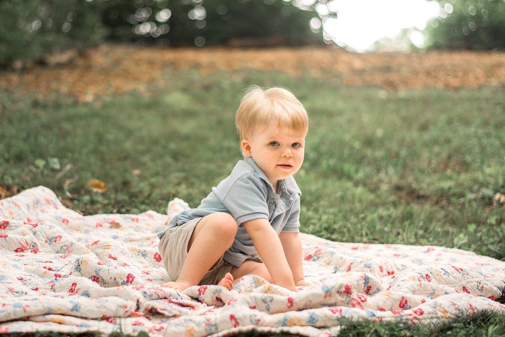toddler boy on quilt