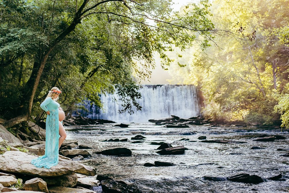 maternity picture of mother in blue gown in front of Roswell Mill Waterfall | What to Wear for Maternity Photos | adriennelouisephotography.com