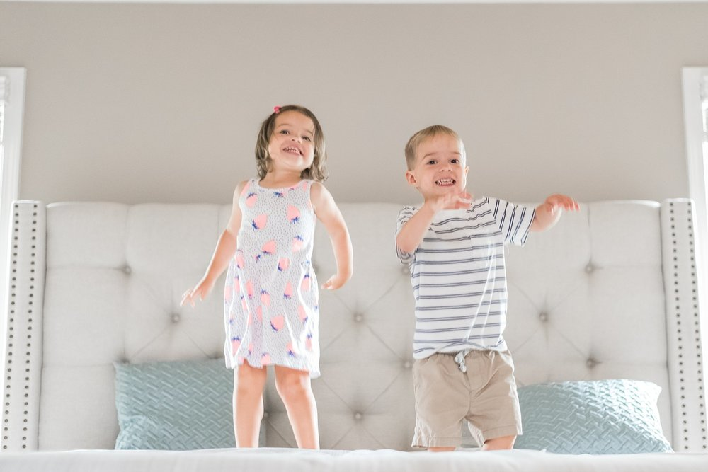 toddler twins jumping on bed