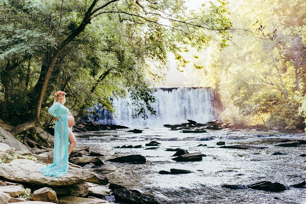 pregnant mom in sheer gown with flower crown at Roswell Mill Waterfall
