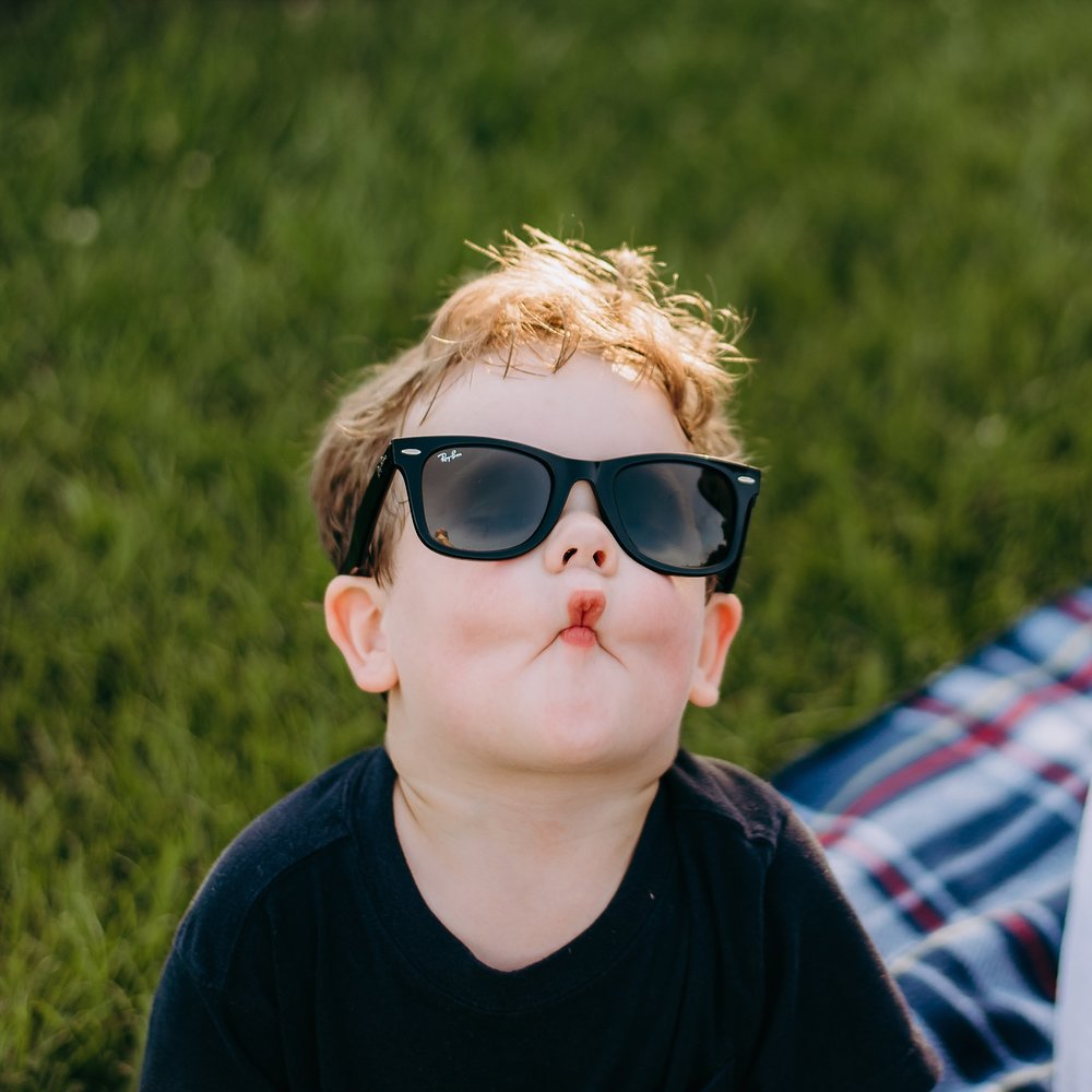 toddler with ray bans on making fish face Lake Acworth Cauble Park