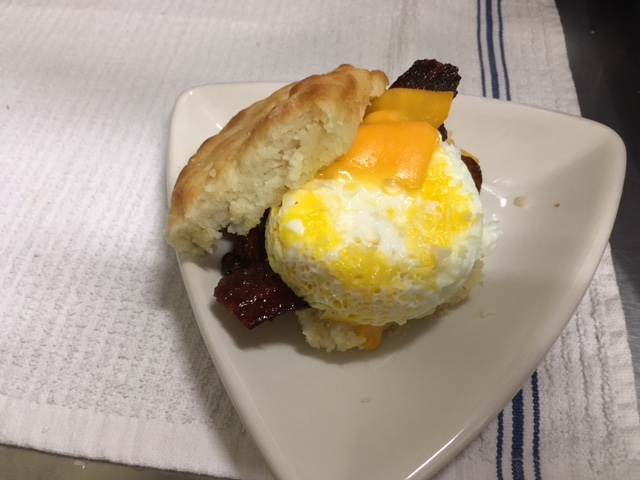 Try the breakfast sandwich on a homemade biscuit with our signature candied cayenne bacon. Deliciously sweet and a little spicy.