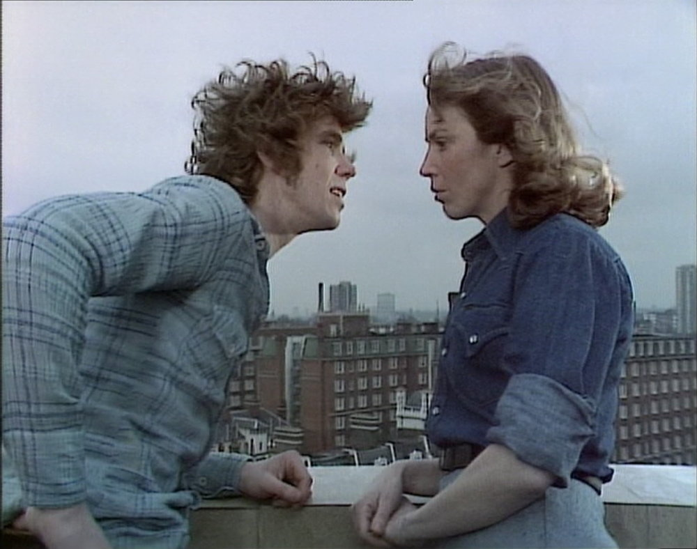 Mick Ford  and  Deborah Norton  in  Hitting Town (1976)