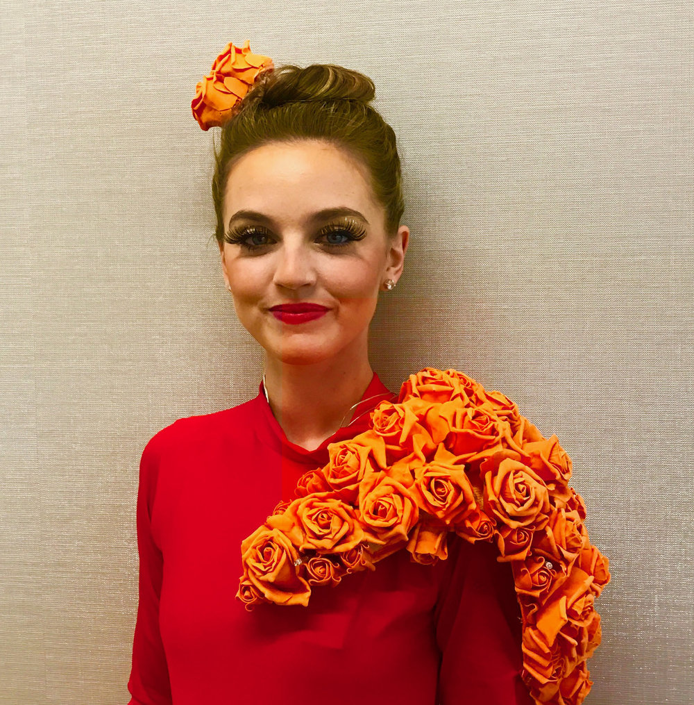 costume, orange rose head dress and chest detail on red dress, Divine Company.jpg