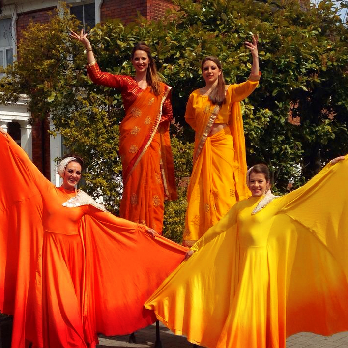 Bollywood, stilt and Optioscope performance, Divine Company.jpg