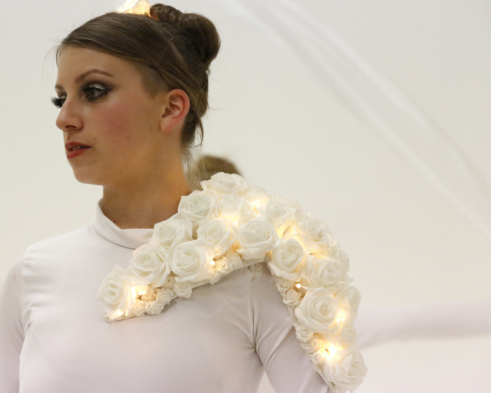 Costume, white illuminated roses in daylight, Divine Company.jpg