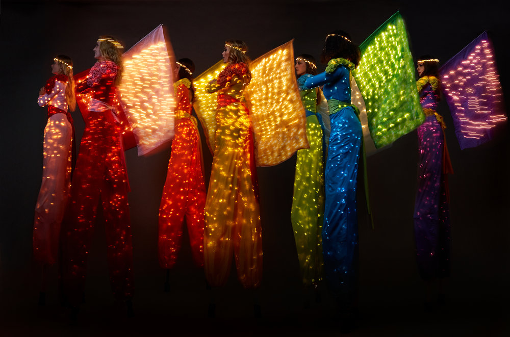Colour Collection, illuminated stilt performance with flags, Divine Company.jpg