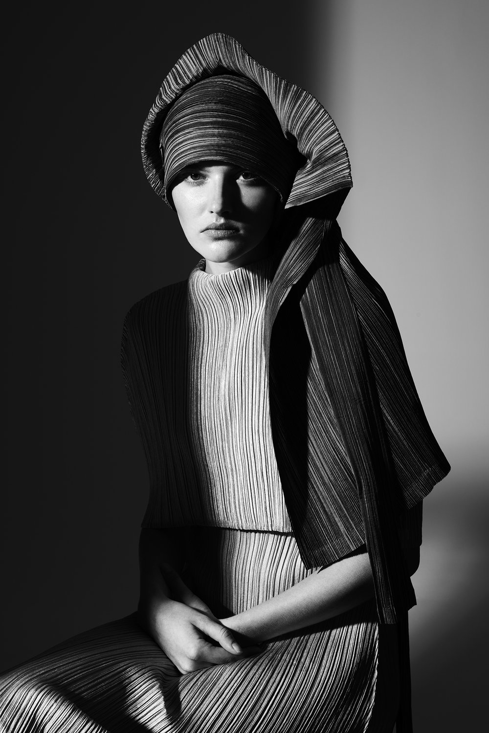 Jacket (as head wrap), Top and skirt ISSEY MIYAKE.