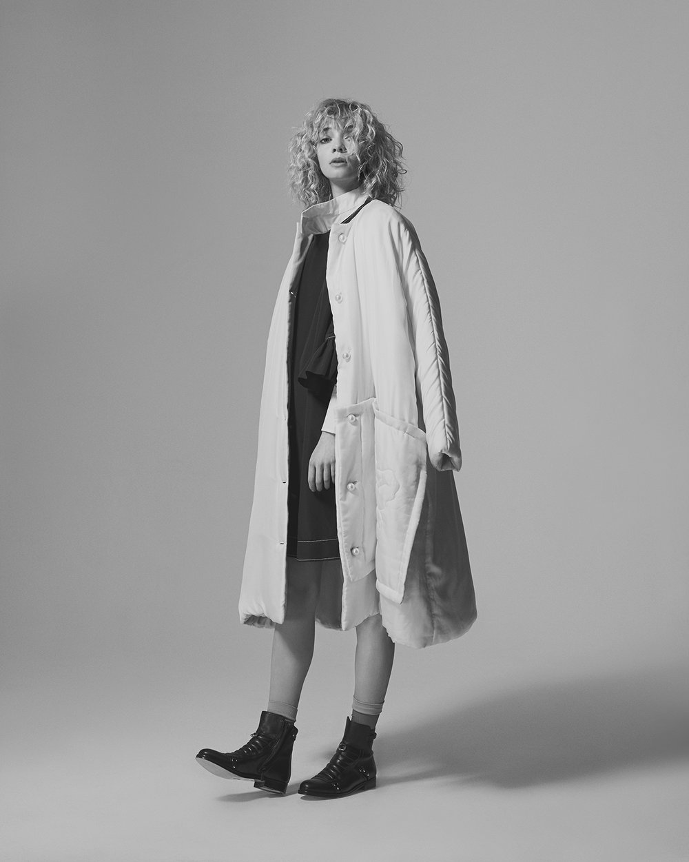 White shirt JAEHA, Blue oversized dress RUI XU, White duvet coat STEVENTAI, Ankle boots JF LONDON, Nude socks ITEM M6.
