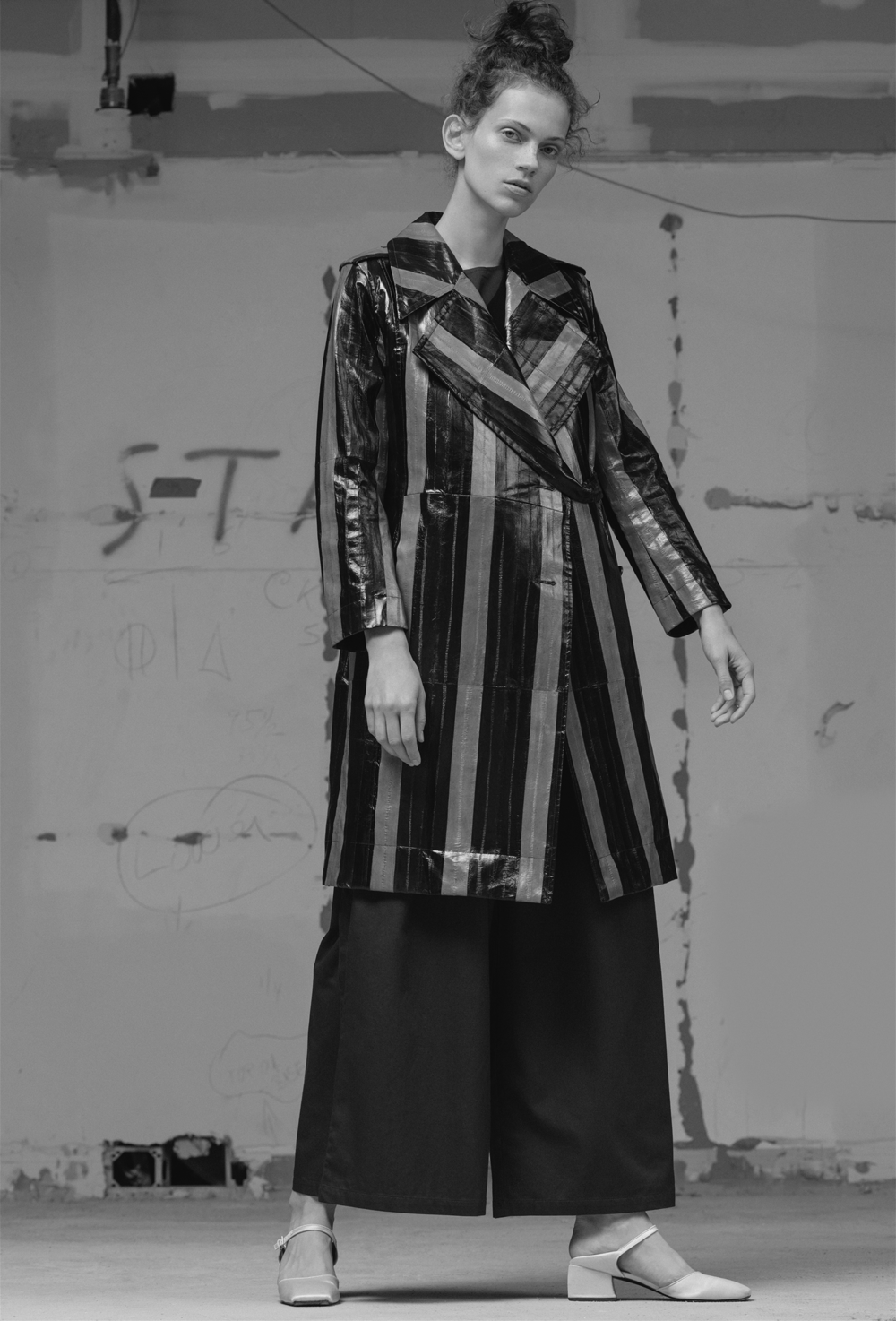 Top KOWTOW, pant KOWTOW, black top CIENNE, coat CREATURES OF THE WIND, shoes SUZANNE RAE, rings SAYAKA DAVIS.