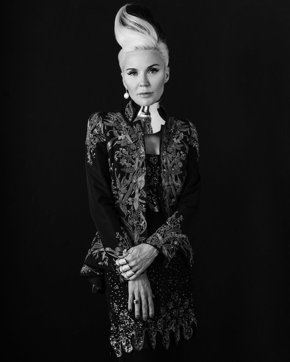 Jacket: Alexander McQueen  Dress: Valentino Haute Couture (from the personal archive of Daphne Guinness)  Neckpiece: Balenciaga