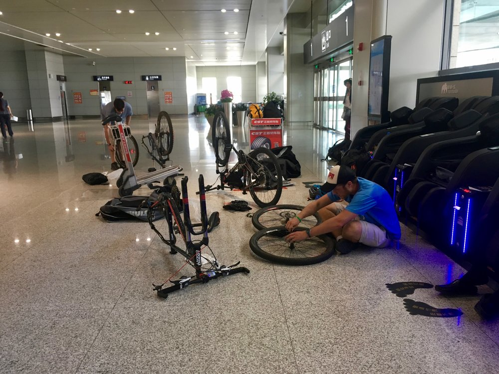 "Departing from Shanghai, we disassembled our bikes, threw them in bags, put ""Fragile"" stickers on them and hoped for the best. No baggage fee and to our surprise we arrived in Xining Airport with our bicycles undamaged.  Apparently U.S. airlines need to take some tips from their competitors across the pond."