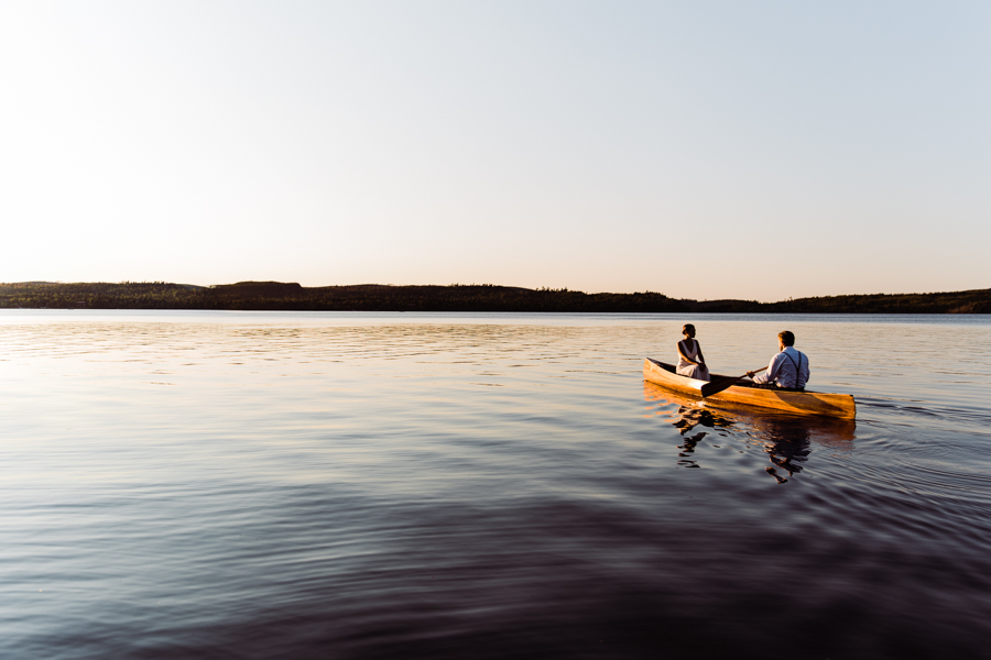bride and groom in canoe at Gunflint Lodge