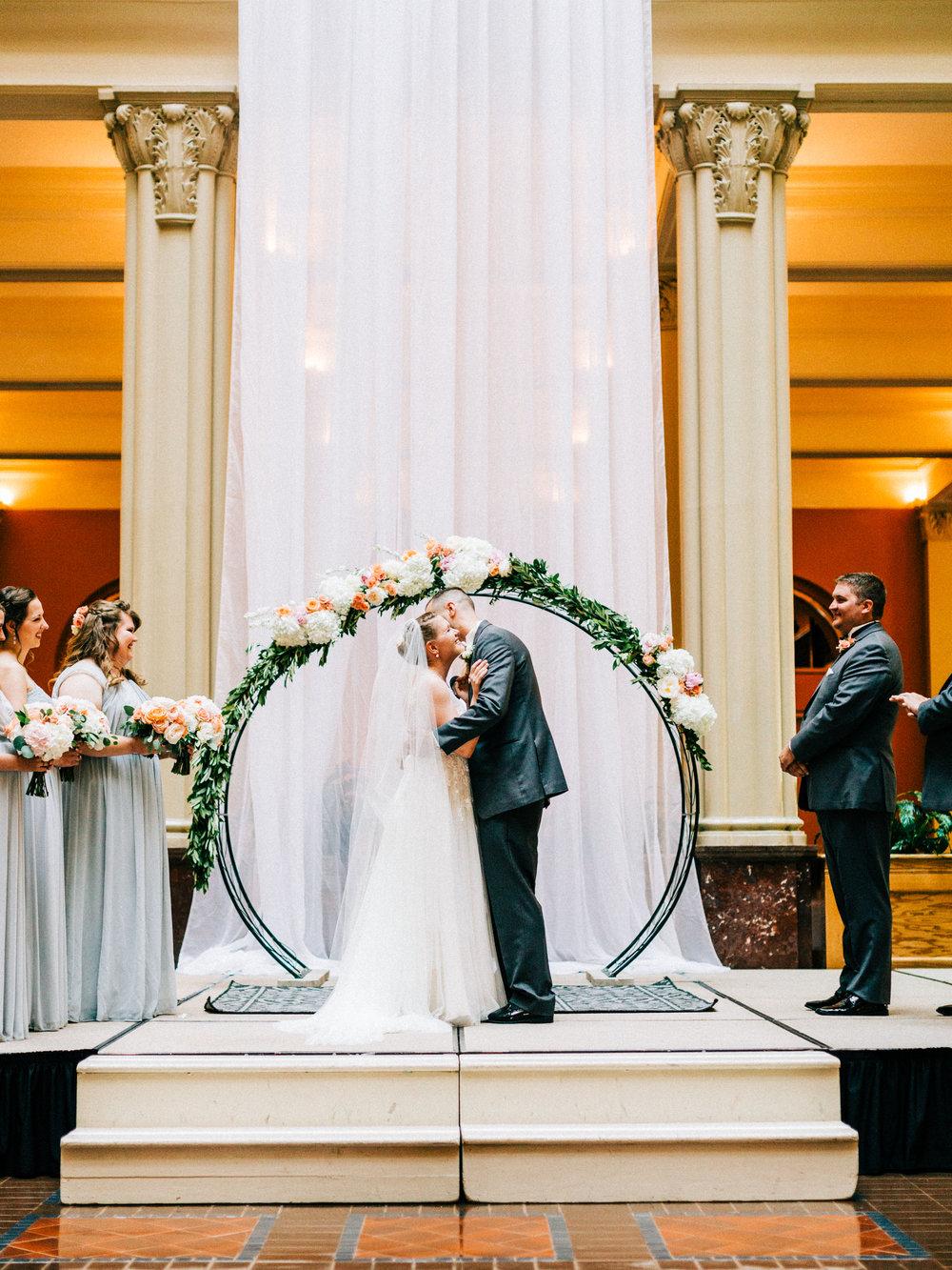 bride and groom kiss at Landmark Center