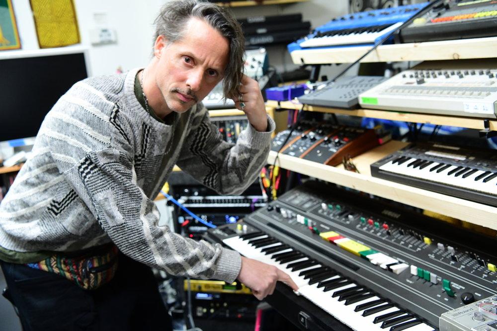 Eddie Ruscha in his studio with his Yamaha C6-60. Photo: Cameron Murray
