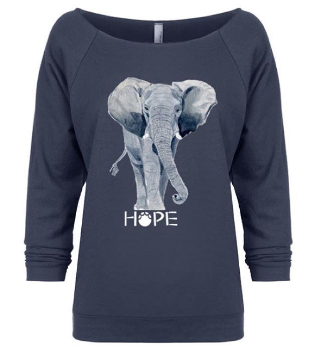 Very special limited edition elephant short. This beautiful hand drawing is from local artist Jane Hutcheson. Jane is very special person who draws from her heart. We are blessed to offer this item to you. Available in white, grey, and slate. Link in bio!