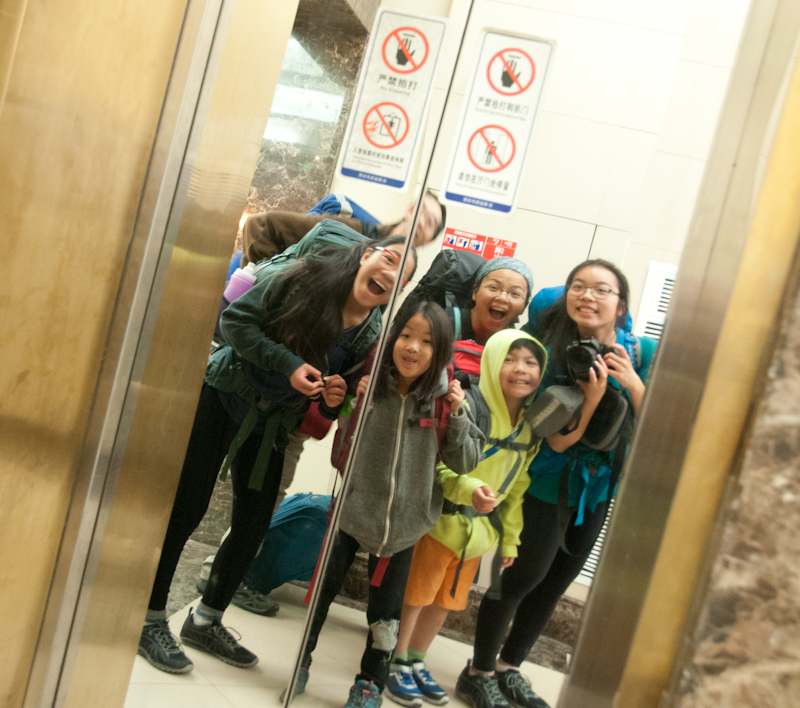 Entering the elevator. We thought it exciting to live above a mall until we saw the apartment...