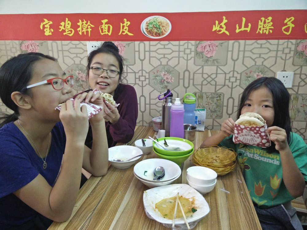The kids discovered  肉夹馍  (Meat sandwich made from beef).They do not want this to end...