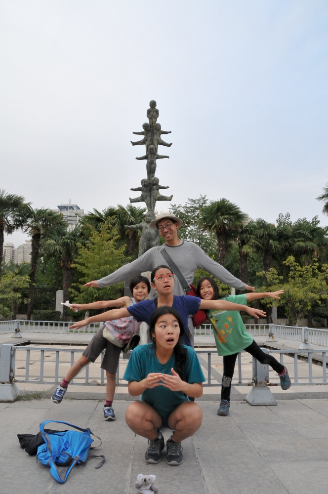 Posing in front of balancing children at the Pagoda #modelife