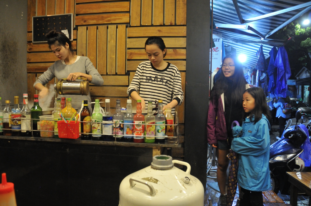 Kids were happy to find frozen yogurt in Hue!  They are made on the spot by pouring dry ice onto yogurt & ingredients.